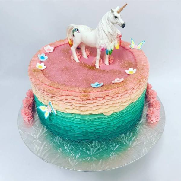 Teal and Pink Frills with Unicorn Figurine