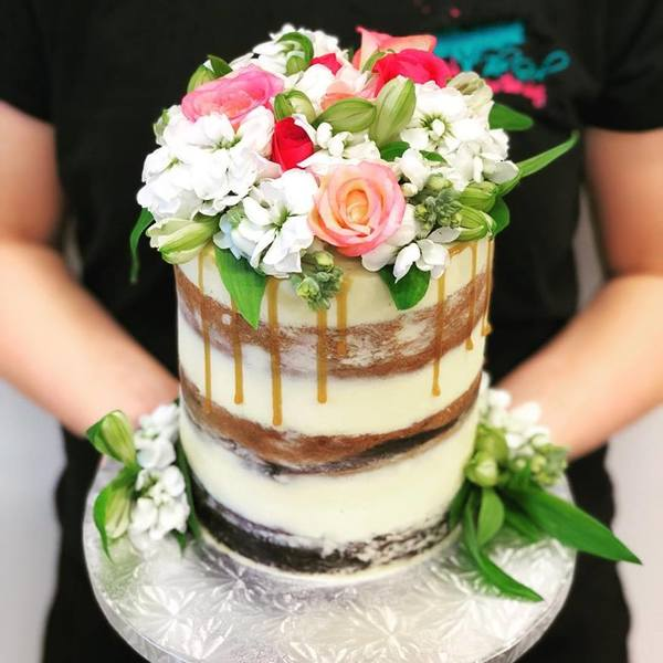 Multi Flavoured Naked Cake with Fresh Flowers and Caramel Drip.