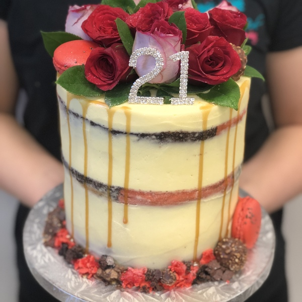 Cream Naked Cake With Fresh Flowers and Toppers