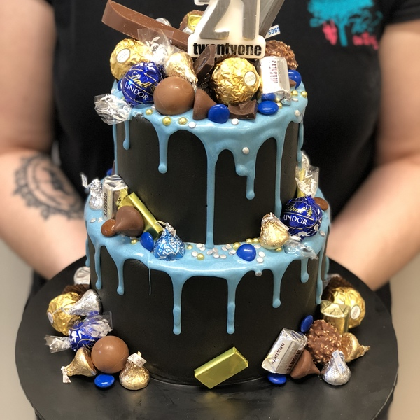 Two Tier Smooth Black With Blue Drip and Chocolate Toppers