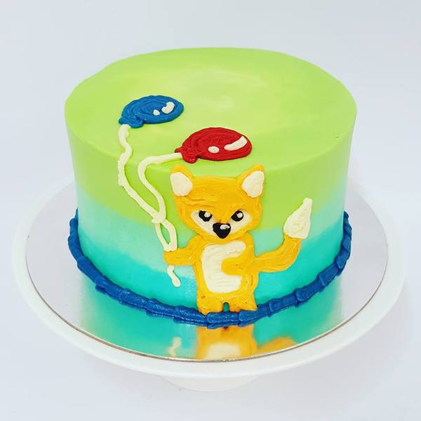 Smooth Cake with Piped Fox and Balloons