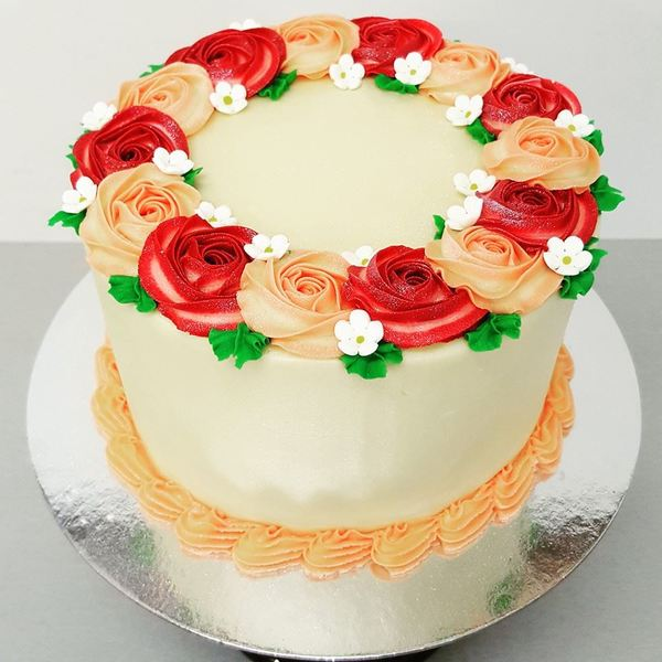 Smooth Cream Cake with Red and Peach Roses