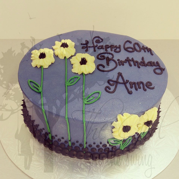 Smooth Blue Cake with Piped Flowers