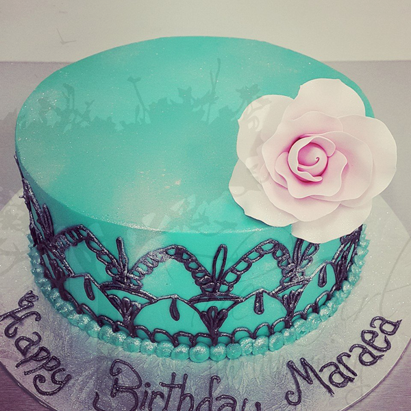 Smooth Blue Cake with Hand Piped Detailing