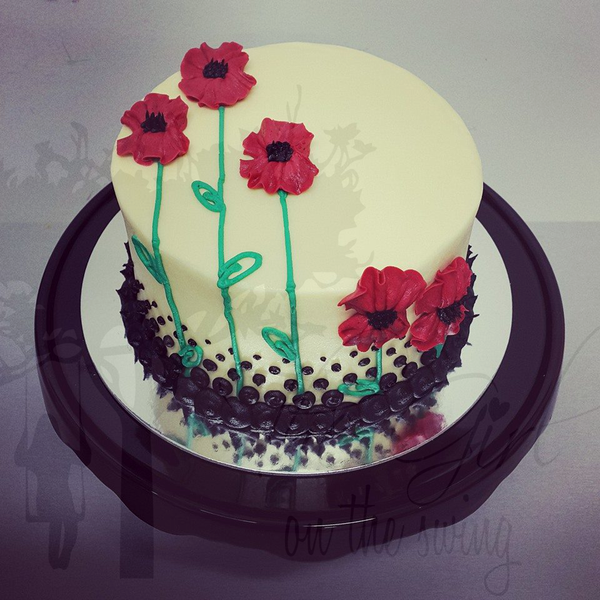 Smooth White Cake with Piped Poppies
