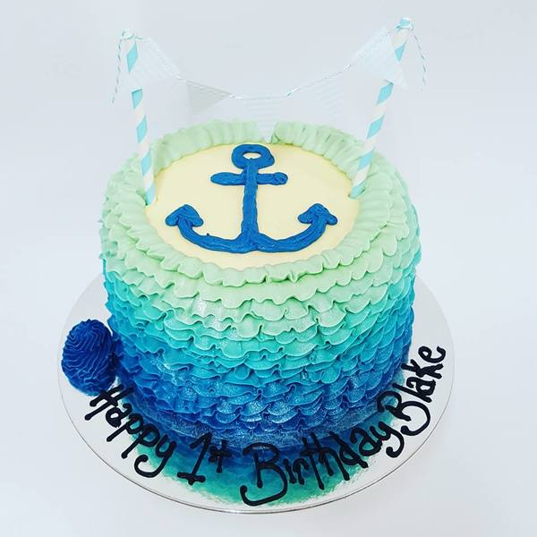 Blue Ombre Frill Cake with Piped Anchor and Bunting