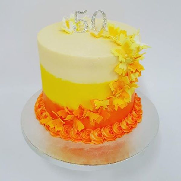 Smooth Three Colour Orange and Yellow Cake with Butterflies