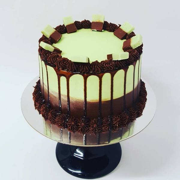 Chocolate and Mint Drip Cake Topped with Fudge
