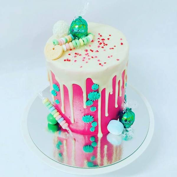 Smooth Bright Pink Cake with White Chocolate Drip and Toppings