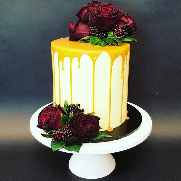 Smooth Cream Cake with Caramel Drip and Fresh Flowers