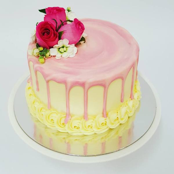 Smooth Cream Cake with Pink Marble Drip and Fresh Flowers