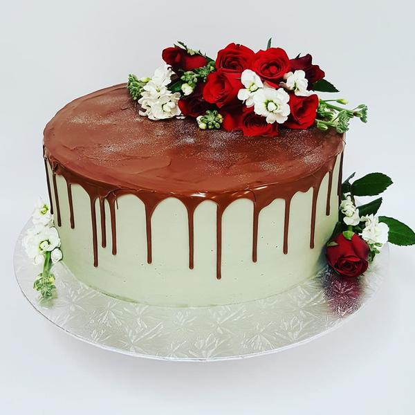Smooth Grey cake with Chocolate Drip and Fresh Flowers
