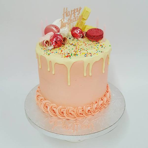 Smooth Light Pink with White Chocolate Drip and Toppings