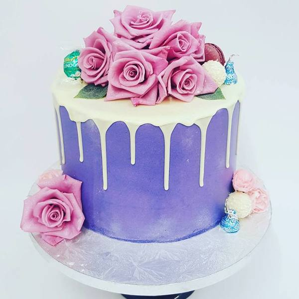 Smooth Purple Drip Cake with Fresh Flowers
