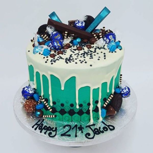 Teal and White Chocolate Drip with Blue Toppings