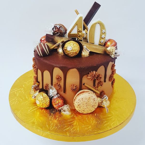 Smooth Chocolate and Gold Overload Cake