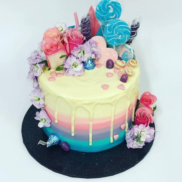 Ombre Blue, Purple, Pink & Cream Drip Cake With Overload Toppings and Fresh Flowers