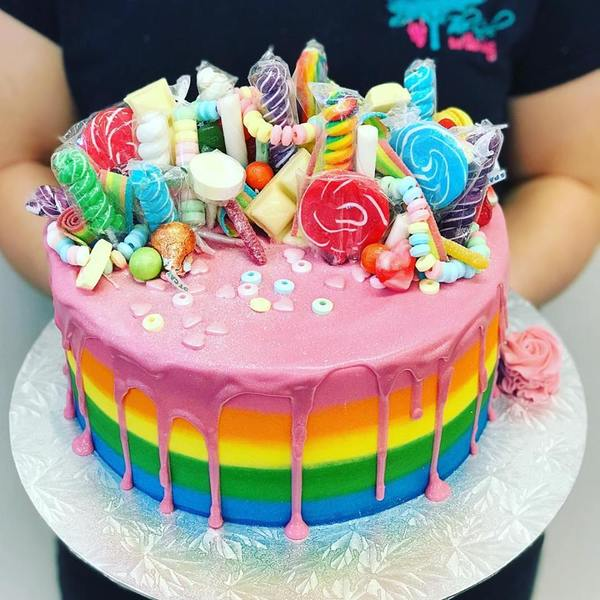 Smooth Rainbow with Pink Drip and Rainbow Overload Toppings