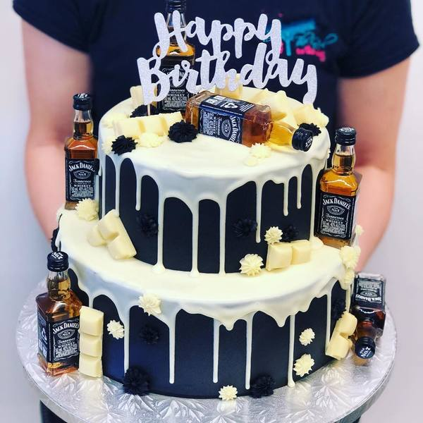 Two Tier Black and Cream Jack Daniels Cake