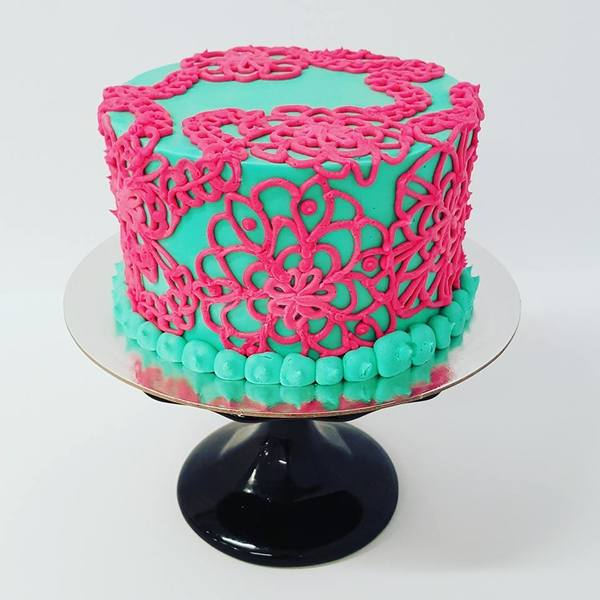 Hand Piped Pink and Teal Cake