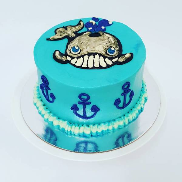 Smooth Blue Cake with Piped Whale and Anchors Cake