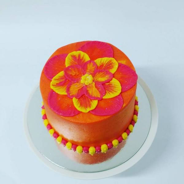 Smooth Orange with Yellow and Pink Flower Cake