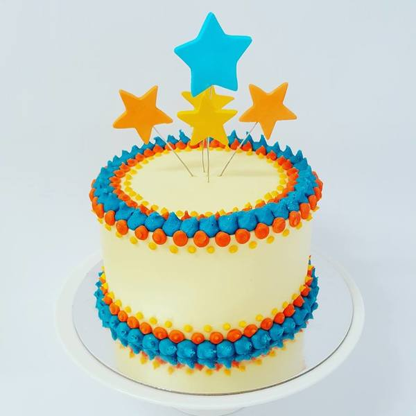 Smooth With Orange and Blue Stars Cake