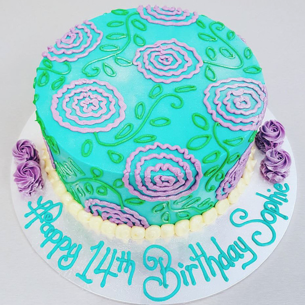 Teal Cake with Piped Purple Flowers