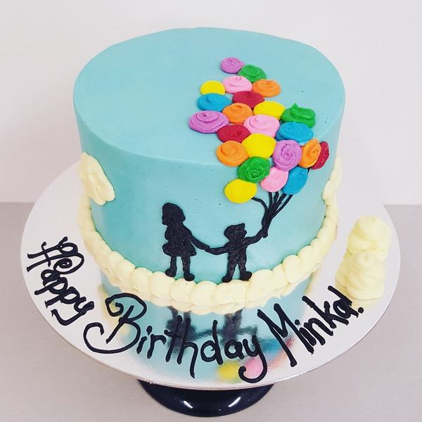 Smooth Blue Cake with Silhouettes and Balloons