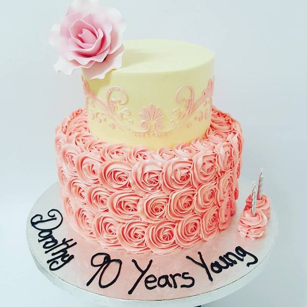 Two Tier Pink and Cream Cake with Roses and Stencil