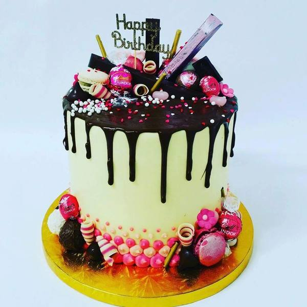 Smooth Cream and Pink Cake with Chocolate Drip and Toppings