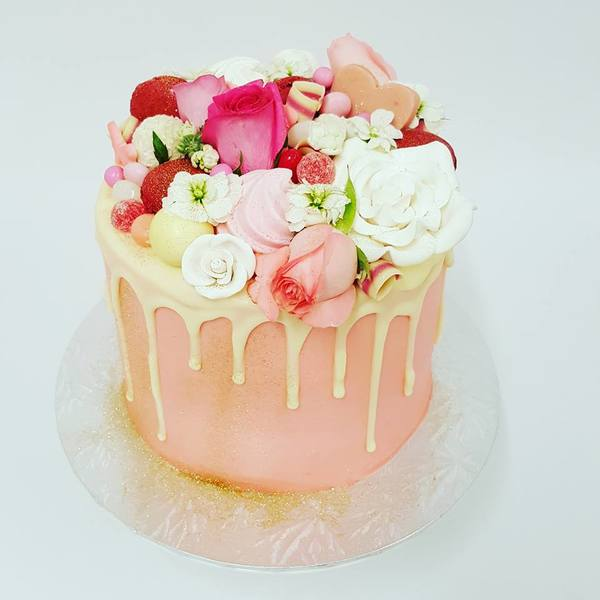 Smooth Light Pink cake with White Chocolate Drip and Overload Toppings
