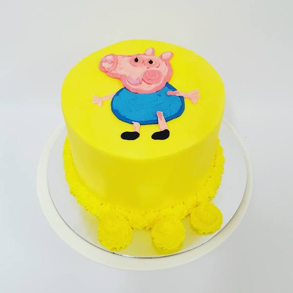 Smooth Yellow Cake with Piped George the Pig